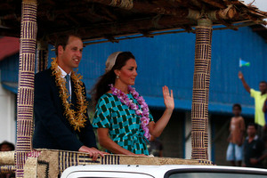 Prince William and wife Kate were greeted by huge crowds as they landed in the Solomon Islands. Photo / AP