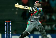 Afghanistan's Mohammad Shahzad plays a shot in their match against India.  Photo / AP