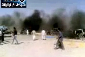 Image taken from video obtained from the Ugarit News, (authenticated based on its contents and other AP reporting), of the site of the petrol station explosion. Photo / AP