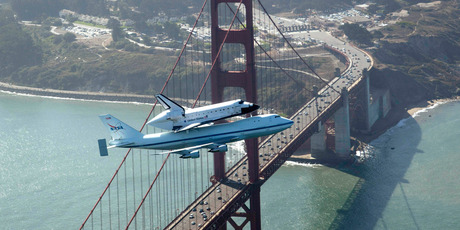 Space shuttle Endeavour and its 747 carrier aircraft soar over the Golden Gate Bridge in San Francisco. Photo / AP