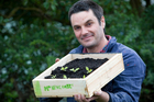 Justin Newcombe with a seed-raising tray. Photo / Richard Robinson