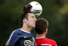 Ivan Vicelich (left) of Auckland City heads the ball as he jumps with Allan Pearce of Waitakere United (right). Photo / Sarah Ivey