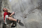 Rock climber Zane Bray trains at the rock wall at Auckland Grammar School. Photo / The Aucklander