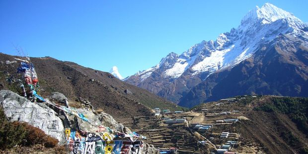 Namche Bazaar sits 3440m up in the Himalayas and has always been a marketplace of goods, customs, beliefs and nationalities. Photo / Jim Eagles
