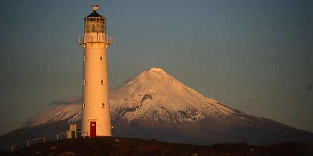 Cape Egmont lighthouse is closely linked to its namesake mountain. Photo / Steve Sole