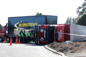 A driver had to be cut free from his truck which overturned at Taupiri. Photo / Christine Cornege