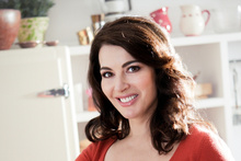 Nigella Lawson says she's messy and the domestic goddess tag doesn't suit her.