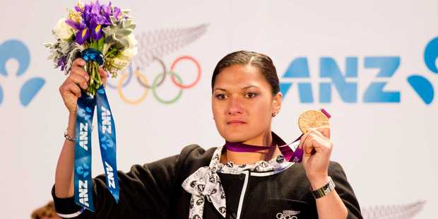 ANZ's logo is prominent as Valerie Adams receives her medal. Photo / Greg Bowker