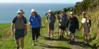 Trampers enjoy the scenery on the walk to Homunga Bay. Photo / Waihi Leader