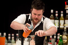 James Goggin races against time to make his cocktail. Photo / Natalie Slade