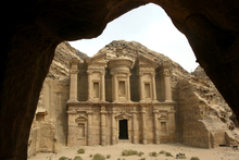 A monastery is framed by a nearby cave in the spectacular ancient Nabataean city of Petra, in Jordan. Photo / Alan Gibson