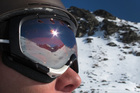 The reflection of The Remarkables range is seen in the goggles of a skier. Photo / Sarah Ivey