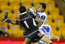 Warrior's Kevin Locke competes for the ball against Bulldogs Ben Barba in an NRL rugby league match. Photo / Wayne Drought