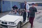 Tommy Ill and friends in a scene from <i>New Car Money</i>.