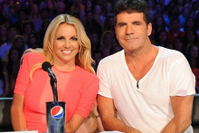 Britney Spears and Simon Cowell try to out-nasty each other on the judges' bench. Photo / AP