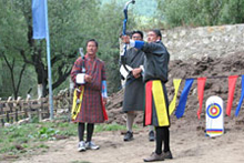 Tshering Wangchuk prepares for a 145-metre shot down the archery range. Photo / Jill Worrall