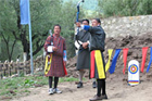 Tshering Wangchuk prepares for a 145-metre shot down the archery range. Photo / Jill Worrall