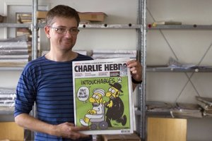 French satirical weekly Charlie Hebdo's publisher, known only as Charb, with the controversial latest issue of the magazine. Photo / AFP