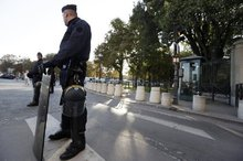 French Gendarmes stand in front of the US embassy on the Champs-Elysees avenue in Paris. Photo / AFP