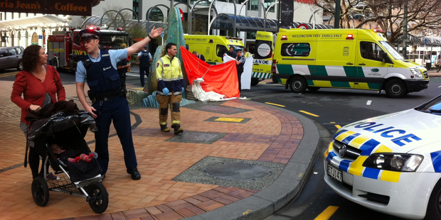 Police and ambulance crews at the scene where a woman died following a fall in central Wellington this morning. Photo / APNZ