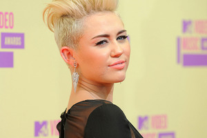 MIley Cyrus has been cleared of assault charges thanks to new video footage. Photo / AP
