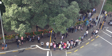 More than 100 people turned up to the money drop. Photo / APNZ