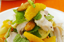 Chicken, artichoke and pistachio salad with mint and orange. Photo / Babiche Martens