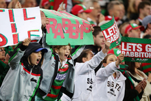 Young Rabbitohs fans cheer on their side. Photo / Getty Images 