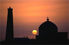 The sun rises behind the Juma minaret and mosque in the town of Khiva, Uzbekistan, which is on the Silk Road, a series of ancient trade routes through Asia. Photo / Getty Images