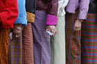 Voters in Bhutan wait to cast their votes. Local politicians had details of their private lives splashed across the media after journalists asked the men's wives to dish the dirt on their husbands. Photo / Reuters