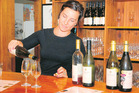 Lauren Simms witha  selection of the offerings at Marsden Estate winery. Photo / Graham Twose