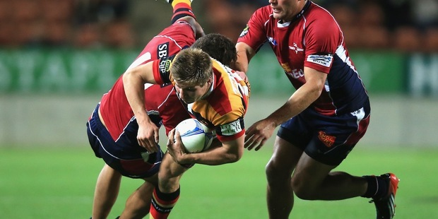 Piers Francis of Waikato is tackled by Peter Betham, left, and Kieron Fonotia of Tasman. Photo / Getty Images