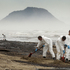 Army personnel pictured at work cleaning up an  oil spill at Papamoa Beach.