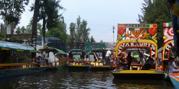 The canals at Xochimilco in Mexico City are filled with colourful gondolas carrying picnicking groups and mariachi bands. Photo / Amy Rosenfeld