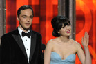 Jim Parsons, left, and Zooey Deschanel present an award onstage at the 64th Primetime Emmy Awards. Photo / AP