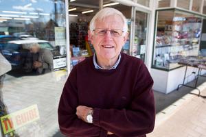 Alan la Roche outside the Readaway Bookshop. Photo / Steven McNicholl