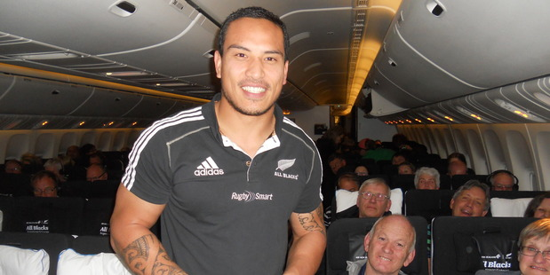 Hosea Gear takes a turn as a flight steward on board Air New Zealand flight 1349 bound for Buenos Aires. Photo / James Ihaka