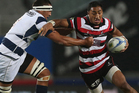 Bundee Aki of Counties Manukau (R) fends off the defence during the round 11 ITM Cup match between Auckland and Counties Manukau at Eden Park. Photo / Getty Images.