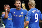 Chelsea's Ashley Cole, left, celebrates his goal against Stoke City with teammates Branislav Ivanovic, center, and Fernando Torres. Photo / AP