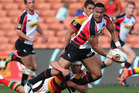 Piers Francis of Waikato tackles Robbie Fruean of Canterbury during the round nine ITM Cup match between Waikato and Canterbury. Photo / Getty Images.