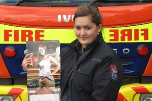Kawakawa firefighter and reluctant pin-up girl Kahlia Scott with the latest New Zealand firefighters calendar. Photo / Supplied