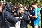 Ritchie McCaw signs autographs for Argentinian ABs' fans. Photo / James Ihaka