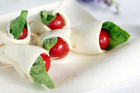 Try tomatoes wrapped in Pugliese mozzarella style cheese. Photo / Doug Sherring