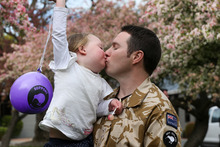 Captain Chris Buerkeman says goodbye to daughter Ruby, 3, at Burnham Army Camp yesterday.  Photo / Getty Images