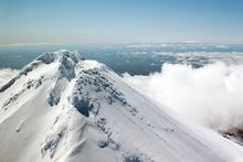 On a clear, calm day you can chopper over Mt Taranaki and see the 120,000-year-old. Photo / Venture Taranaki