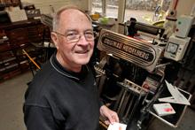 Graham O'Keeffe can indulge his passion for printing at Motat. Photo / Michael Craig