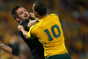 Richie McCaw and Quade Cooper have had several run-ins. Photo / Getty Images