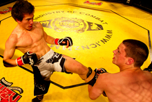 Cameron Quertier and Joesph Spiers battle it out in the 69kgs B Class bout, during the ICNZ18 MMA (Mixed Martial Arts) Championship held at North Shore Events Centre, Auckland. Photo / Brett Phibbs