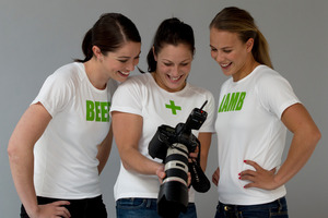 Paralympian Sophie Pascoe tries her hand at photography to the amusement of Sarah Walker (left) and Lisa Carrington. Photo / Brett Phibbs