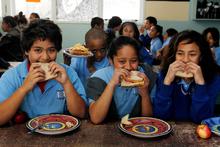 Pupils (from left) Oshiana Papara, 12, Beyna Simon, 11, and Te Pare Kelly, 11, enjoy the lunch provided by Te Wharekura O Te Kaokaoroa O Patetere school in Putaruru. Photo / Christine Cornege